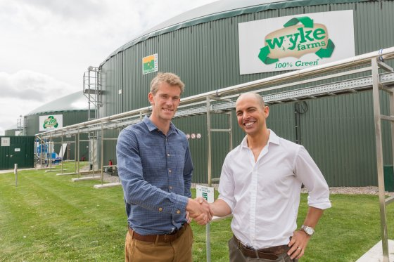 14/07/2015 Visit to Wyke Farms near Bruton, Somerset, by Good Energy team to view the anaerobic digestion plants generating electricity which Good Energy buys. Good Energy's head of sales and business development Alex Orme (left) shakes on the deal made with Wyke Farms' commercial manager Dan Rumley.